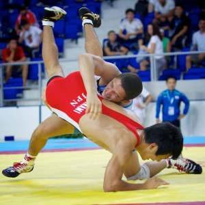 Aaron Pico (top) defeated Japan's Yuhi Fujinami for the 138.75-pound freestyle title in the Cadet Worlds.