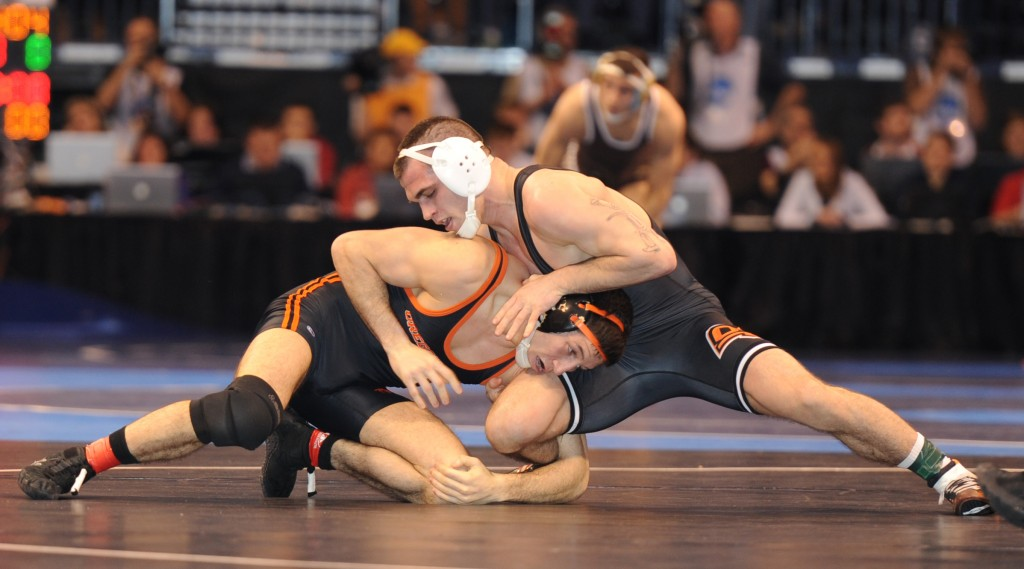 Oklahoma State's Josh Kindig (right) earned his first All-American round with his quarterfinal round victory over Oregon State's Scott Sakaguchi. (Ginger Robinson photo)