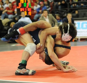 Illinois' Jesse Delgado (top) held on to defeat Penn State's Nico Megaludis in double overtime of their Big Ten final, which was a rematch of last year's NCAA final won by the Illini