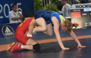 Whitney Conder (right) scored first against China's Xuechun Zhong but could not escape the second-round loss at 53 kilos. (Ginger Robinson photo)